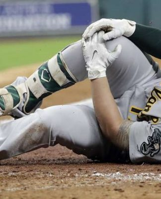 Yonder Alonso Scratched From A's Lineup After Injury